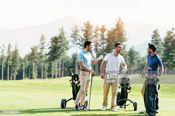 golf team - golfer stock pictures, royalty-free photos & images