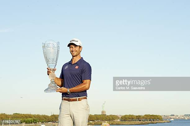 The Barclays Adam Scott victorious with trophy after winning tournament on Sunday at Liberty National GC FedEx Cup Jersey City NJ CREDIT Carlos M...