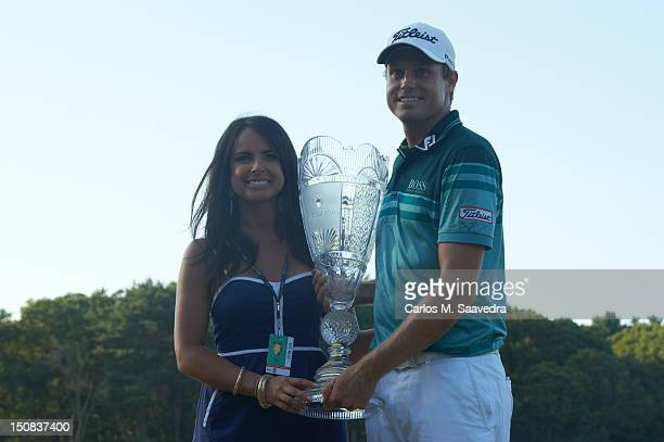 The Barclays Nick Watney victorious holding trophy with wife Amber after winning tournament on Sunday at Bethpage Black Course FedEx Cup Farmingdale...