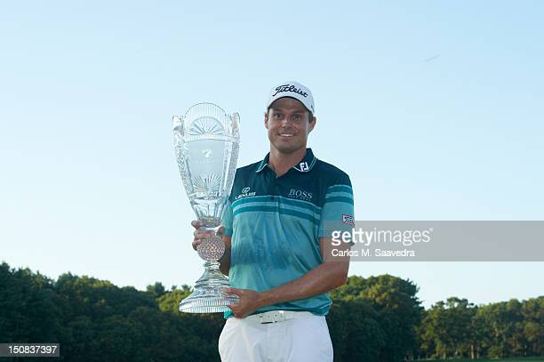 The Barclays Nick Watney victorious with trophy after winning tournament on Sunday at Bethpage Black Course FedEx Cup Farmingdale NY CREDIT Carlos M...