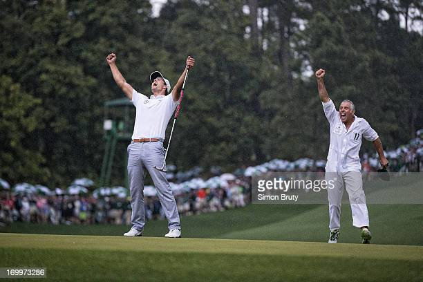 The Masters Adam Scott victorious with caddie Steve Williams on No 10 green after winning tournament during sudden death playoff on Sunday at Augusta...