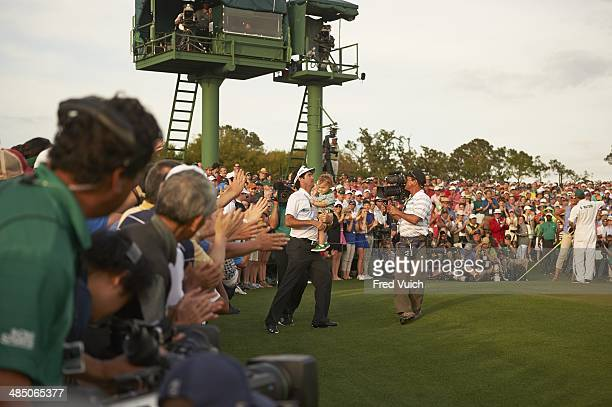 Bubba Watson victorious, holding son Caleb after winning tournament during Sunday play at Augusta National. Augusta, GA 4/13/2014 CREDIT: Fred Vuich