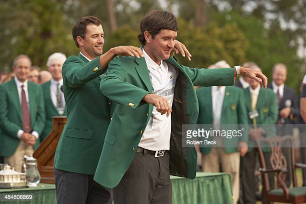 The Masters Bubba Watson victorious receiving green jacket from Adam Scott during ceremony after winning tournament on Sunday at Augusta National...