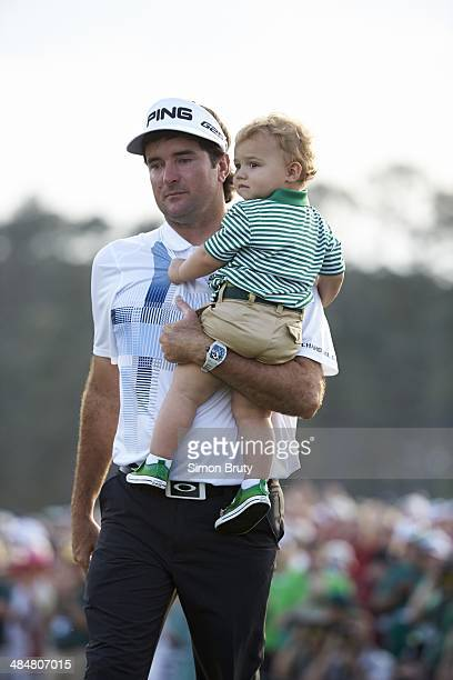 Bubba Watson victorious with his son Caleb Watson at No 18 hole after winning tournament on Sunday at Augusta National. Augusta, GA 4/13/2014 CREDIT:...