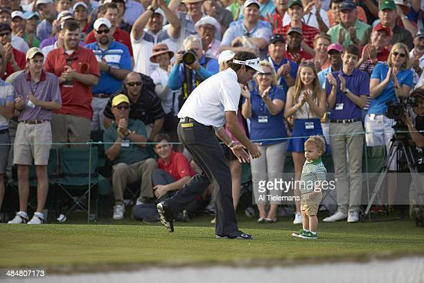The Masters Bubba Watson victorious with his son Caleb Watson at No 18 hole after winning tournament on Sunday at Augusta National Augusta GA CREDIT...