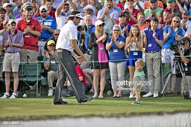 The Masters Bubba Watson victorious with his son Caleb Watson on No 18 gree after winning tournament on Sunday at Augusta National Augusta GA CREDIT...