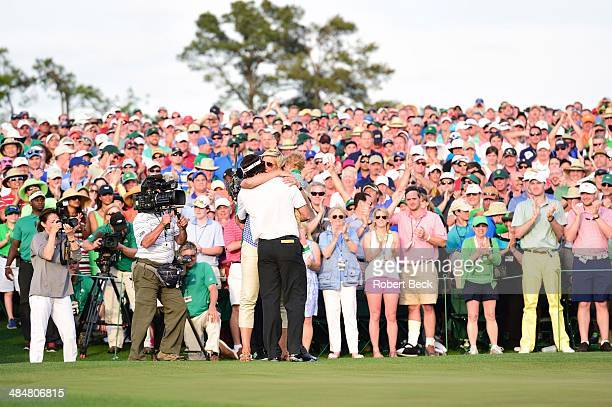 Bubba Watson victorious with his wife Angie Watson and son Caleb Watson at No 18 hole after winning tournament on Sunday at Augusta National....