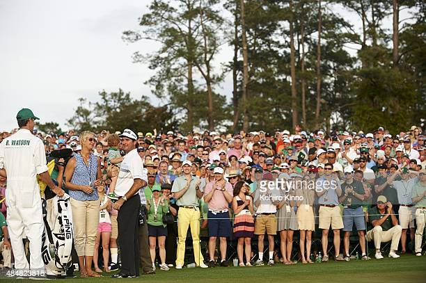 The Masters Bubba Watson victorious with his wife Angie Watson and son Caleb Watson at No 18 hole after winning tournament on Sunday at Augusta...