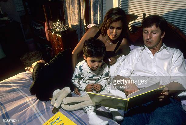 The Masters Casual portrait of Brandel Chamblee reading a bedtime story with his wife Karen Chamblee and son Brandel Chamblee Jr during photo shoot...
