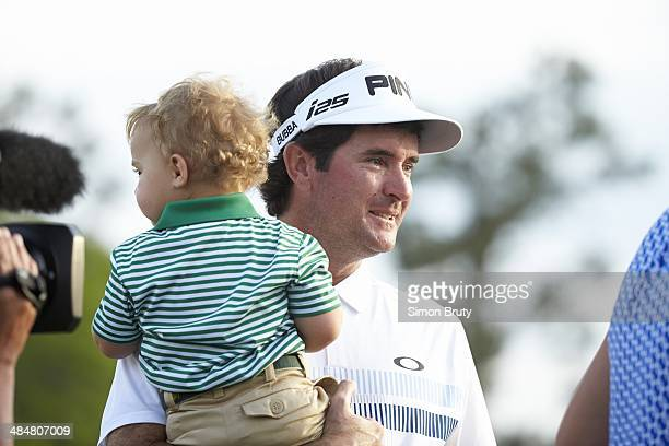 The Masters Closeup of Bubba Watson victorious with his son Caleb Watson at No 18 hole after winning tournament on Sunday at Augusta National Augusta...