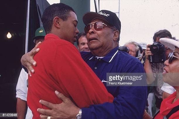 Golf The Masters Closeup of Tiger Woods victorious with father Earl Woods after winning tournament on Sunday at Augusta National Augusta GA 4/13/1997