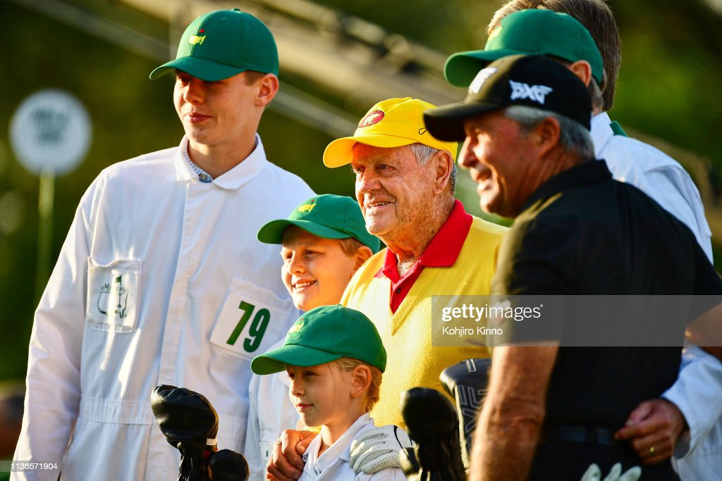 Jack Nicklaus and Gary Player posing for photo with children