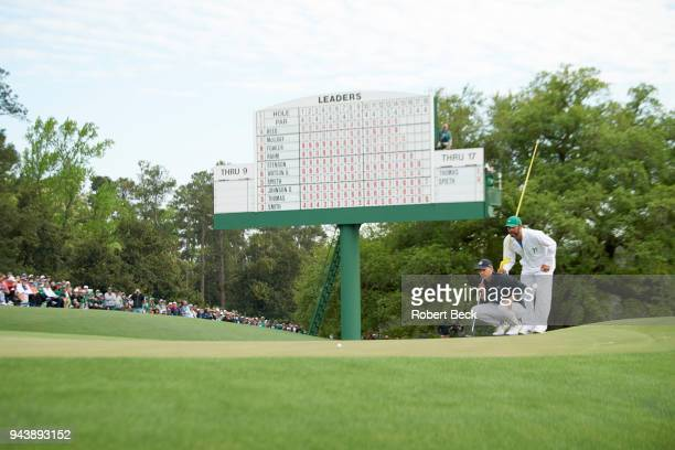 The Masters Jordan Spieth lining up putt with caddie during Sunday play at Augusta National Augusta GA CREDIT Robert Beck
