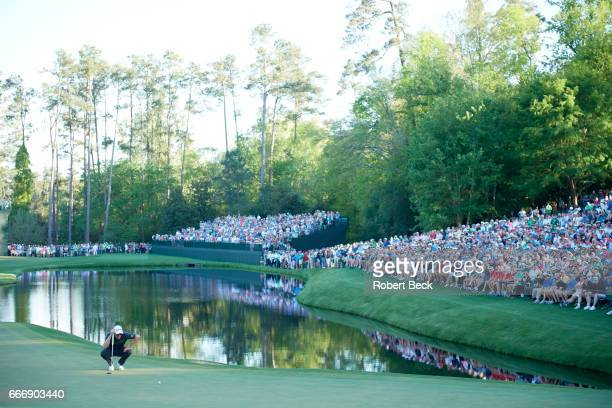 The Masters Justin Rose lining putt on No 16 green during Sunday play at Augusta National Augusta GA CREDIT Robert Beck