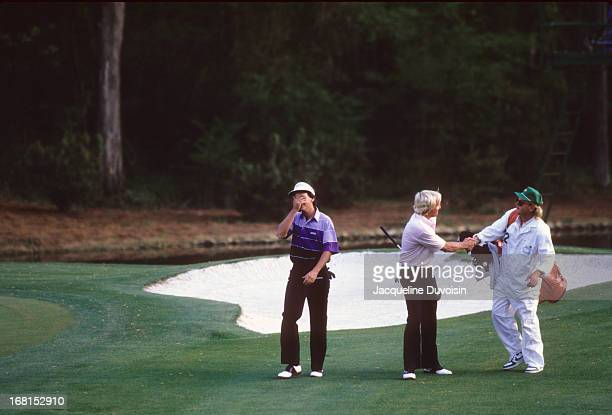 Larry Mize victorious after making chip shot on No 11 hole during playoff to win tournament on Sunday at Augusta National. View of Greg Norman...