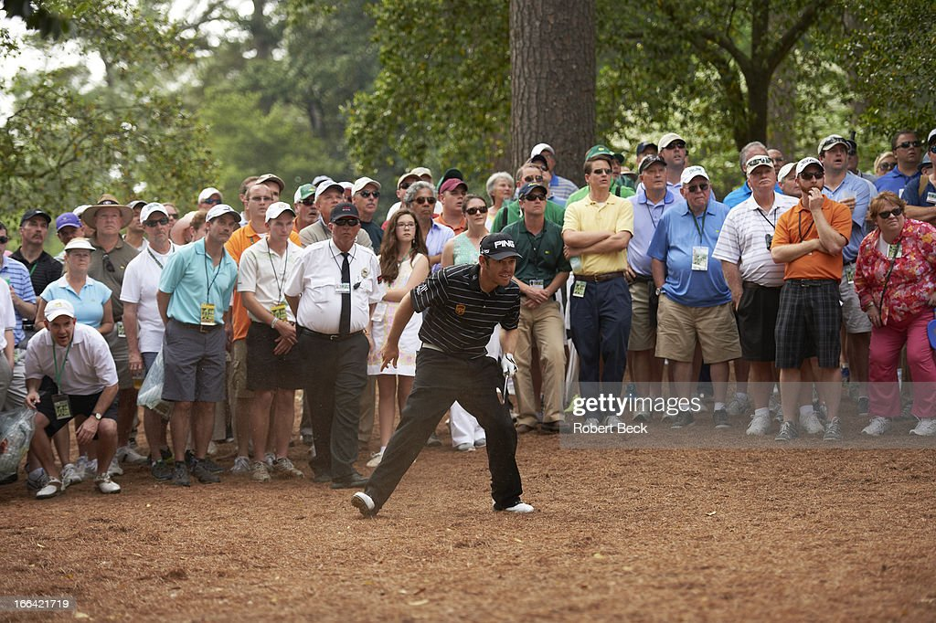 Louis Oosthuizen watches his ball from woods during Thursday play at Augusta National. Robert Beck F146 )