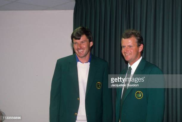 The Masters Nick Faldo wearing green jacket after winning tournament with previous winner Sandy Lyle after Sunday play at Augusta National Augusta GA...