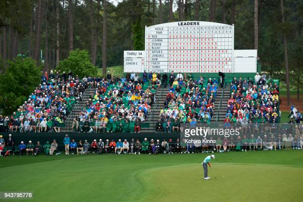 The Masters Overall view of Jordan Spieth in action putt during Saturday play at Augusta National View of spectators in stands and leaderboard...