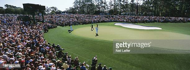 The Masters Panoramic scenic view of Tiger Woods and David Howell walking on No 18 green during round 3 on Sunday at Augusta National Augusta GA...