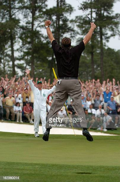 The Masters Phil Mickelson victorious jumping in air after winning tournament on Sunday at Augusta National View of caddie Jim Bones Mackay Augusta...