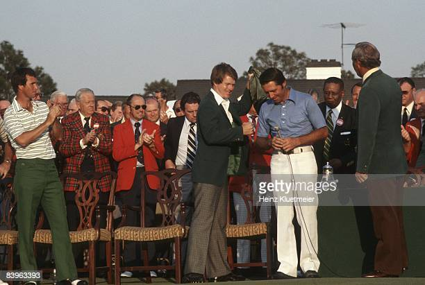 The Masters Previous year's winner and current runnerup Tom Watson giving green blazer to winner Gary Player at Augusta National Golf Course Augusta...
