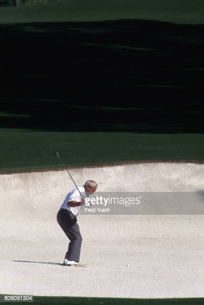 The Masters Rear view of Arnold Palmer in action chipping from sand trap at Augusta National GC Augusta GA CREDIT Fred Vuich