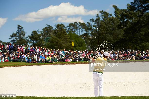 The Masters Rear view of Bryson DeChambeau in action hitting third shot out of bunker on No 2 hole during Friday play at Augusta National Augusta GA...