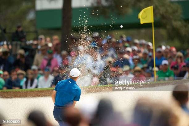 The Masters Rear view of Jordan Spieth in action from sand during Friday play at Augusta National Augusta GA CREDIT Kohjiro Kinno