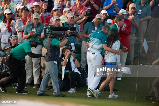 The Masters Rear view of Sergio Garcia victorious with fiance Angela Akins during Sunday play at Augusta National Augusta GA CREDIT Al Tielemans