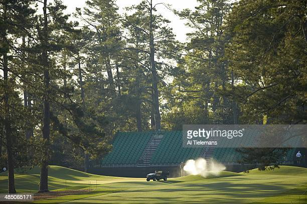 The Masters Scenic view of groundskeepers watering No 8 green before Saturday play at Augusta National Augusta GA CREDIT Al Tielemans