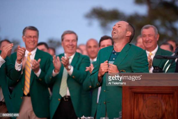 The Masters Sergio Garcia victorious at podium during green jacket ceremony after Sunday play at Augusta National Augusta GA CREDIT Al Tielemans