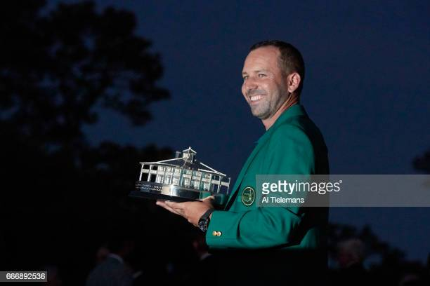 The Masters Sergio Garcia victorious holding The Masters Trophy and wearing green jacket after Sunday play at Augusta National Augusta GA CREDIT Al...