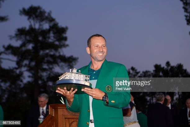 The Masters Sergio Garcia victorious holding The Masters Trophy and wearing green jacket during ceremony after Sunday play at Augusta National...