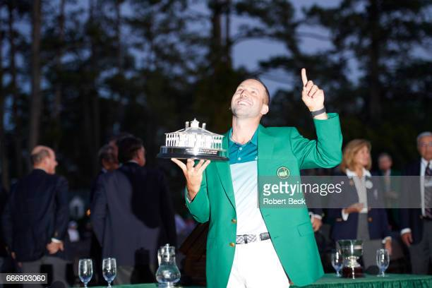 The Masters Sergio Garcia victorious wearing green jacket and holding The Masters Trophy during ceremony after Sunday play at Augusta National...