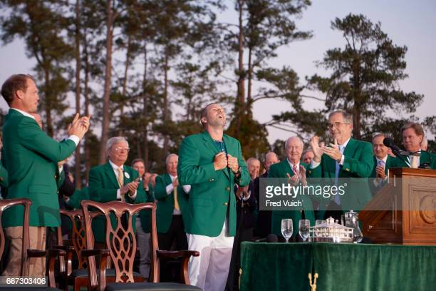 The Masters Sergio Garcia victorious wearing green jacket during ceremony after Sunday play at Augusta National Augusta GA CREDIT Fred Vuich
