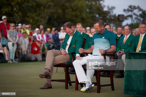 The Masters Sergio Garcia victorious with Danny Willett during green jacket ceremony after Sunday play at Augusta National Augusta GA CREDIT Al...