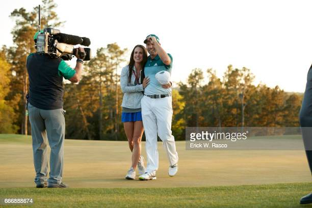 The Masters Sergio Garcia victorious with his fiancee Angela Akins after winning playoff and tournament on Sunday at Augusta National Augusta GA...