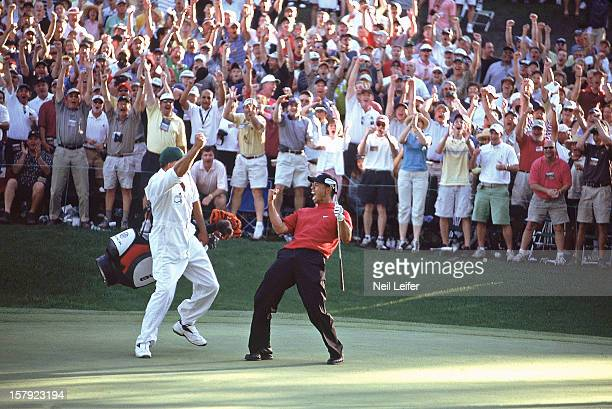 Tiger Woods and caddie Steve Williams victorious after making chip on No 16 hole during Sunday play at Augusta National. Augusta, GA 4/10/2005...