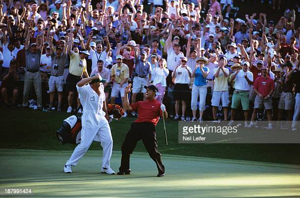 The Masters Tiger Woods and caddie Steve Williams victorious after making chip on No 16 hole during Sunday play at Augusta National Augusta GA CREDIT...