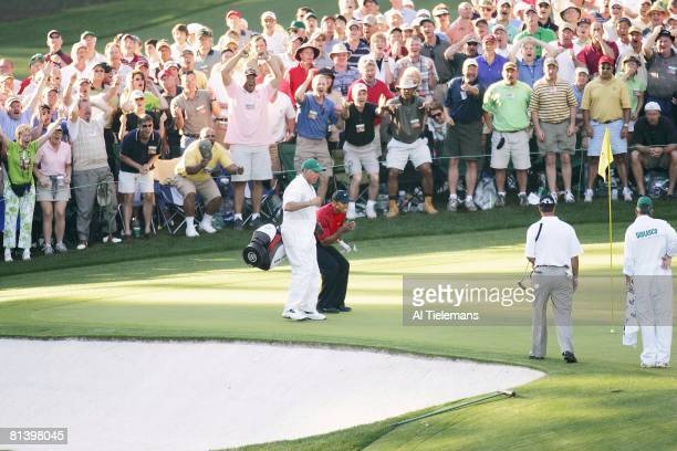 Golf The Masters Tiger Woods and caddie Steve Williams victorious after making 16th hole birdie chip during final round on Sunday at Augusta National...