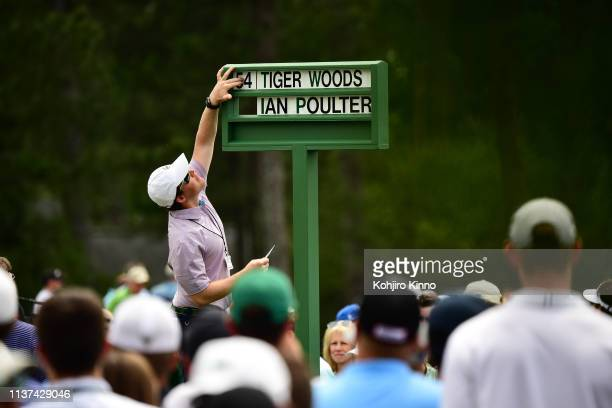 The Masters Tiger Woods and Ian Poulter sign on No 1 tee during Saturday play at Augusta National Augusta GA CREDIT Kohjiro Kinno