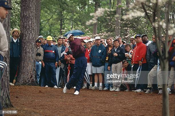 Golf: The Masters, Tiger Woods in action from rough on Thursday at Augusta National, View of fans in gallery, Augusta, GA 4/6/1995