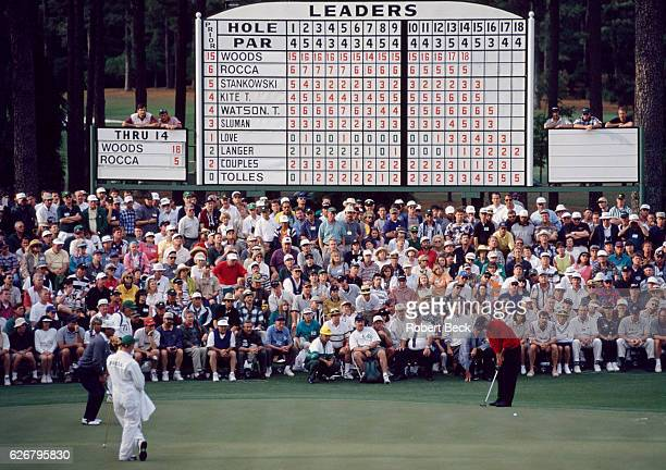 The Masters Tiger Woods in action putt on No 15 green on Sunday at Augusta National View of leaderboard Augusta GA CREDIT Robert Beck