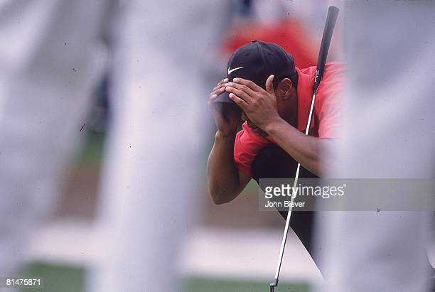 Golf The Masters Tiger Woods lining up putt during Sunday play at Augusta National Augusta GA 4/13/1997