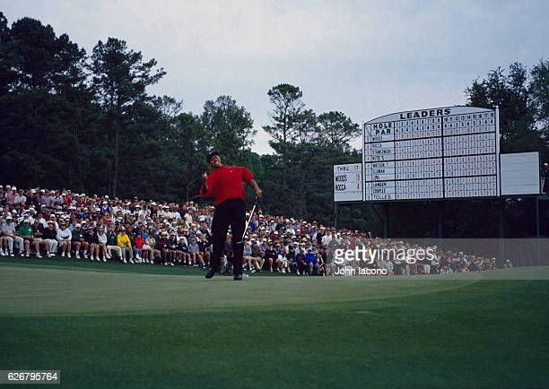 The Masters Tiger Woods victorious pumping fist after sinking putt on No 18 green during Sunday play at Augusta National Augusta GA CREDIT John Iacono