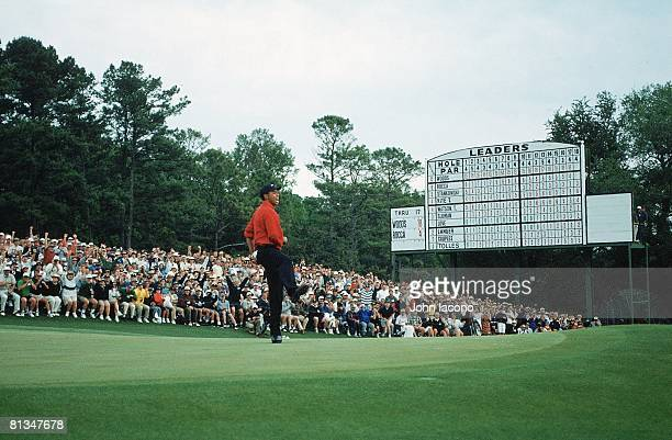 Golf The Masters Tiger Woods victorious winning tournament after making par putt on No 18 during Sunday play View of leader board at Augusta National...