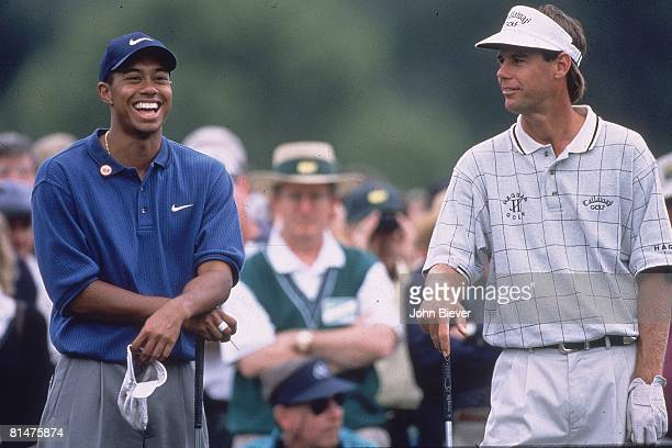 Golf The Masters Tiger Woods with Paul Azinger during Friday play at Augusta National Augusta GA 4/11/1997