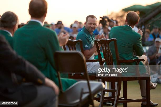 The Masters View from rear of Sergio Garcia seated with Danny Willett during during green blazer ceremony after winning playoff and tournament on...