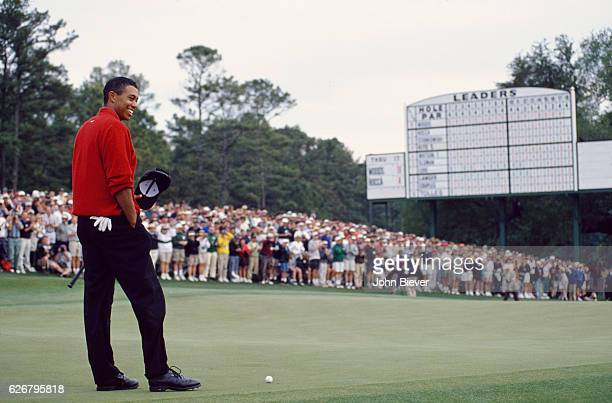 The Masters View of Tiger Woods on No 18 green during Sunday play at Augusta National View of leaderboard in background Augusta GA CREDIT John Biever