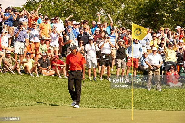 The Memorial Tiger Woods victorious after making 51 foot downhill flop shot from rough for birdie on No 16 during Sunday play at Muirfield Village GC...